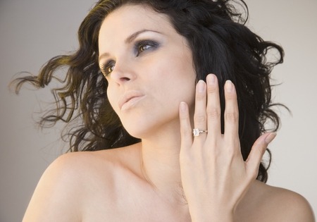 Portrait of woman with diamond ring