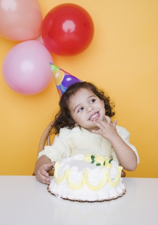 Portrait of young girl with birthday cake Stock Photo