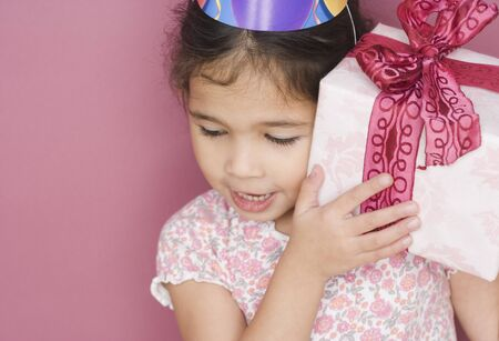 zeal: Girl with birthday gift and hat
