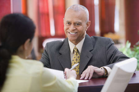 ninetys: Businessman smiling at receptionist
