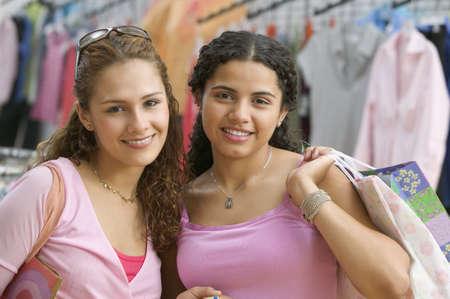 kinfolk: Portrait of two teenage girls shopping