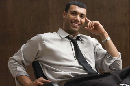 puerto rican: Portrait of businessman sitting and smiling