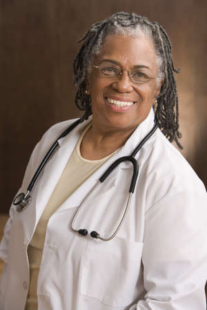 Portrait of female doctor smiling Stock Photo