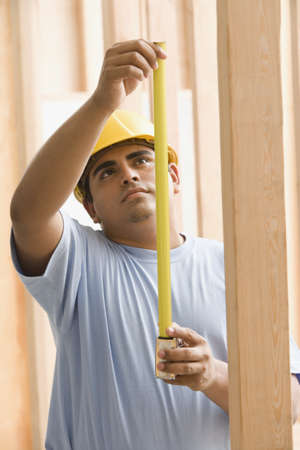 thirtys: Construction worker with measuring tape