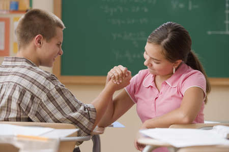 arm: Students arm wrestling in class