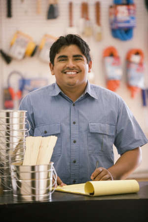giver: Male employee smiling for the camera