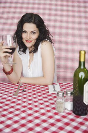 resturant: Portrait of woman in resturant drinking wine