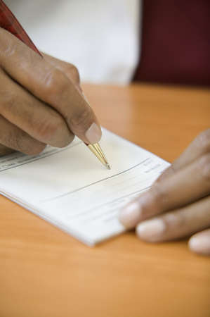 mid life: Close up of hand writing prescription LANG_EVOIMAGES