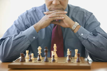 pawn adult: Man concentrating on chess game LANG_EVOIMAGES