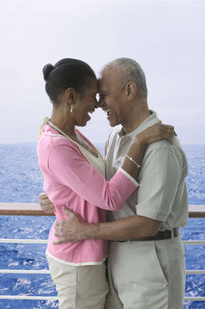 idealistic: Couple laughing and hugging on cruise ship