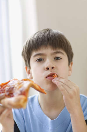 thirty's: Portrait of boy eating pizza