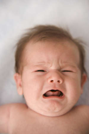 Close up of baby crying LANG_EVOIMAGES