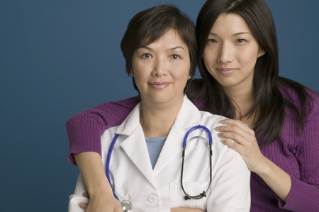 daydreamer: Doctor posing for the camera with her daughter