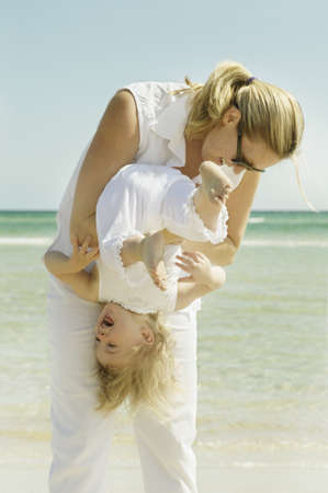 pacific islander ethnicity: Mother and daughter playing on the beach