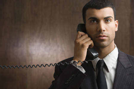 acknowledging: Businessman talking on phone