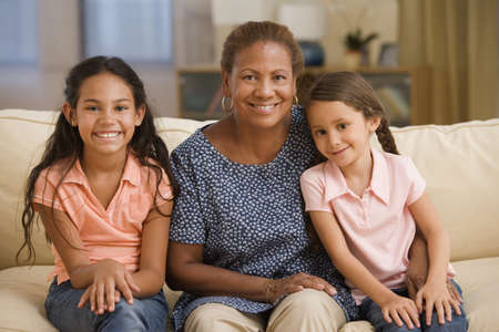 solicitous: Mother and daughters smiling for the camera together