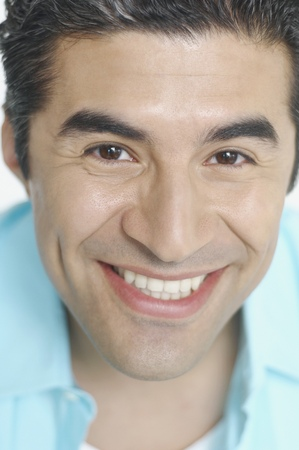 casualness: Close up of young man smiling for the camera
