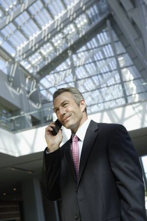 acknowledging: Businessman talking on cell phone