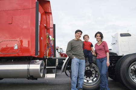 Family standing by their truck Stock Photo