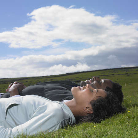 slumbering: Couple laying in grass together