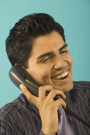lower section view: Young businessman talking on the phone