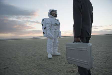 nite: Astronaut and businessman greeting each other