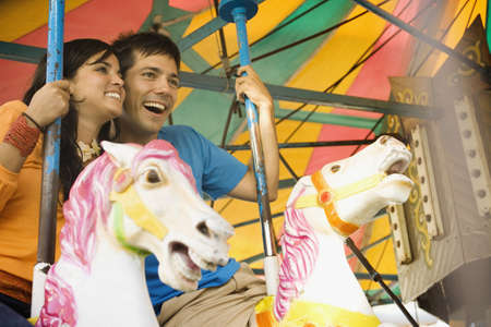 low spirited: Couple riding a rollercoaster
