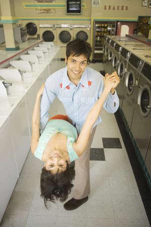 laundromat: Couple dancing in a laundromat