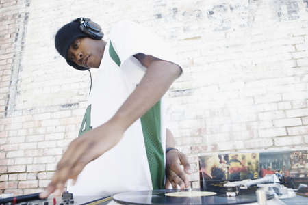 turntables: Teenage boy using turntables and headphones LANG_EVOIMAGES