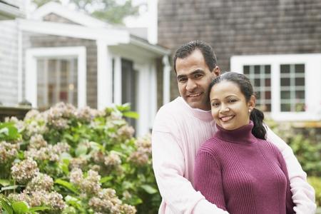 adoring: Couple hugging outdoors