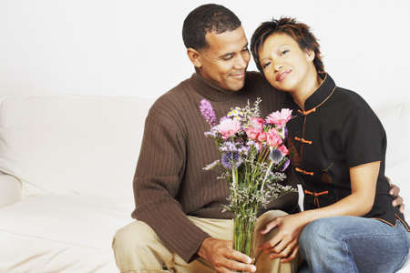 davenport: Couple holding a vase of flowers