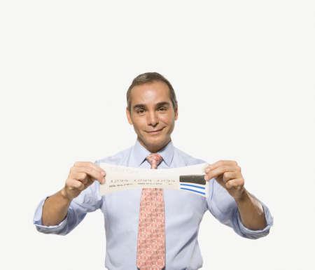 tugging: Businessman stretching a credit card LANG_EVOIMAGES