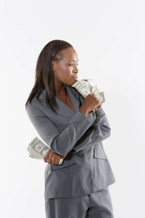 wads: Businesswoman holding wads of cash