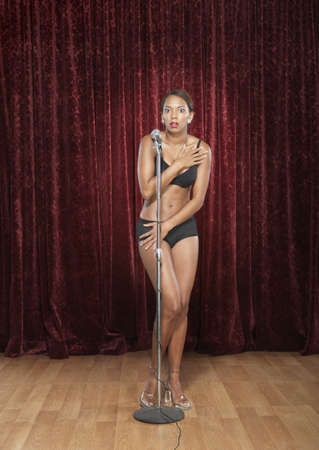 prevailing: Woman in her underwear onstage