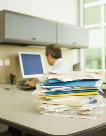 all under 18: Stack of papers on businessmans desk