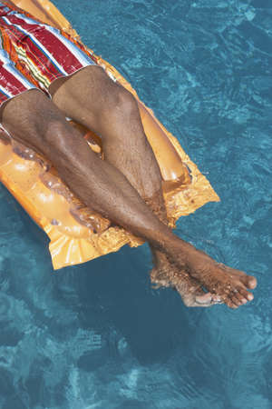 poppa: Man relaxing on an inflatable raft LANG_EVOIMAGES