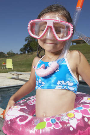 bathingsuit: Young girl in scuba gear LANG_EVOIMAGES