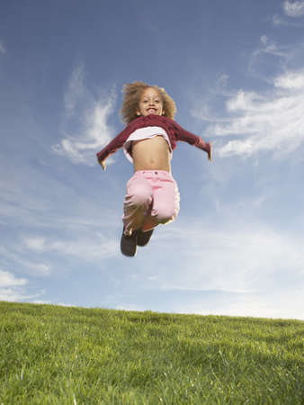 lighthearted: Young girl jumping for joy