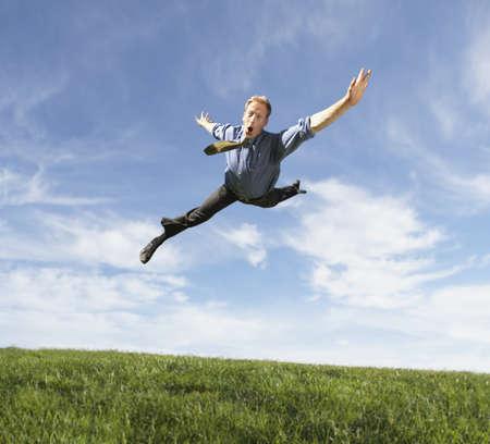 low spirited: Businessman jumping for joy
