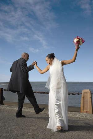 honeymooner: Newlyweds dancing on a pier