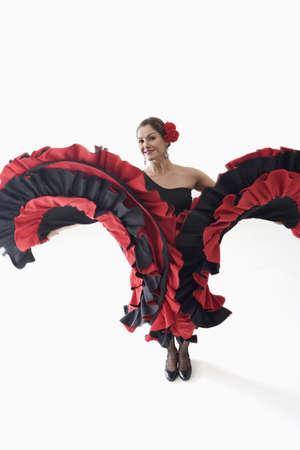 melodramatic: Salsa dancer twirling her skirts LANG_EVOIMAGES