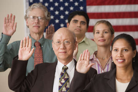attentiveness: Adults raising their right hands before American flag