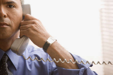 acknowledging: Businessman talking on the phone