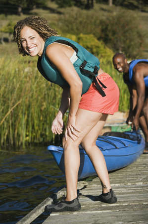 truelove: Young woman smiling with canoe LANG_EVOIMAGES