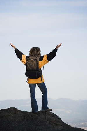 gratifying: Young woman overlooking her surroundings