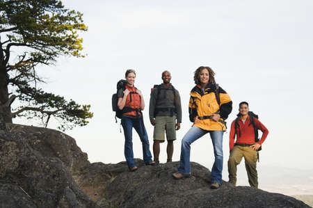 gratifying: Friends hiking on rocky terrain LANG_EVOIMAGES