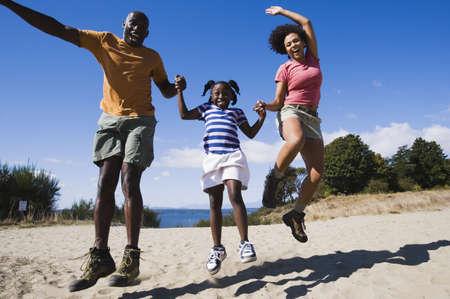 truelove: Family jumping for joy on the beach