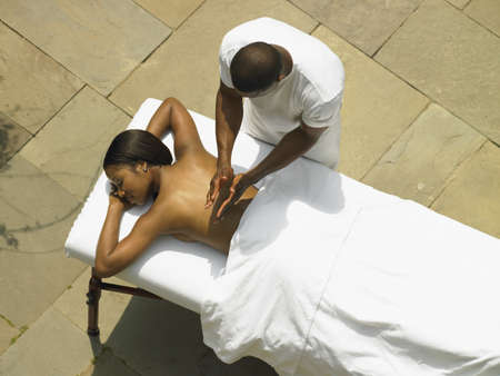 solicitous: Young woman having a back massage LANG_EVOIMAGES