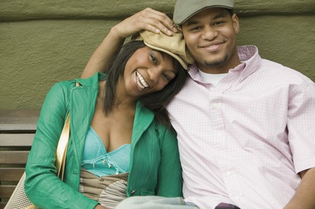 africanamerican: Young couple smiling for the camera LANG_EVOIMAGES