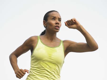 low spirited: Female athlete running